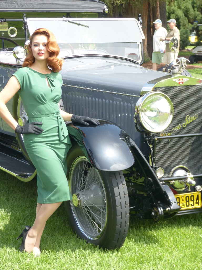 I don't know who this exteremely attractive model is, but she was there as part of a professional photo shoot taking place around this fabulous Hispano Suiza town car limo, and she just had it all.  Her outfit, hair and makeup were perfect and she moved and post with style and class