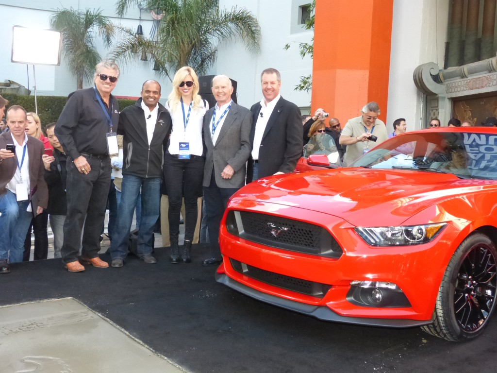 Proud Team Mustang Ford Execs grip and grin with notable Ford racers John and Ash Force and