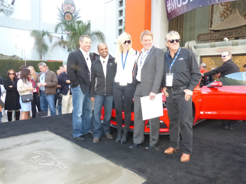 Now you get a better look at the celebrated cement footprint block, plus Henry Ford III, second from right, joins the crowd in Parnelli's place.