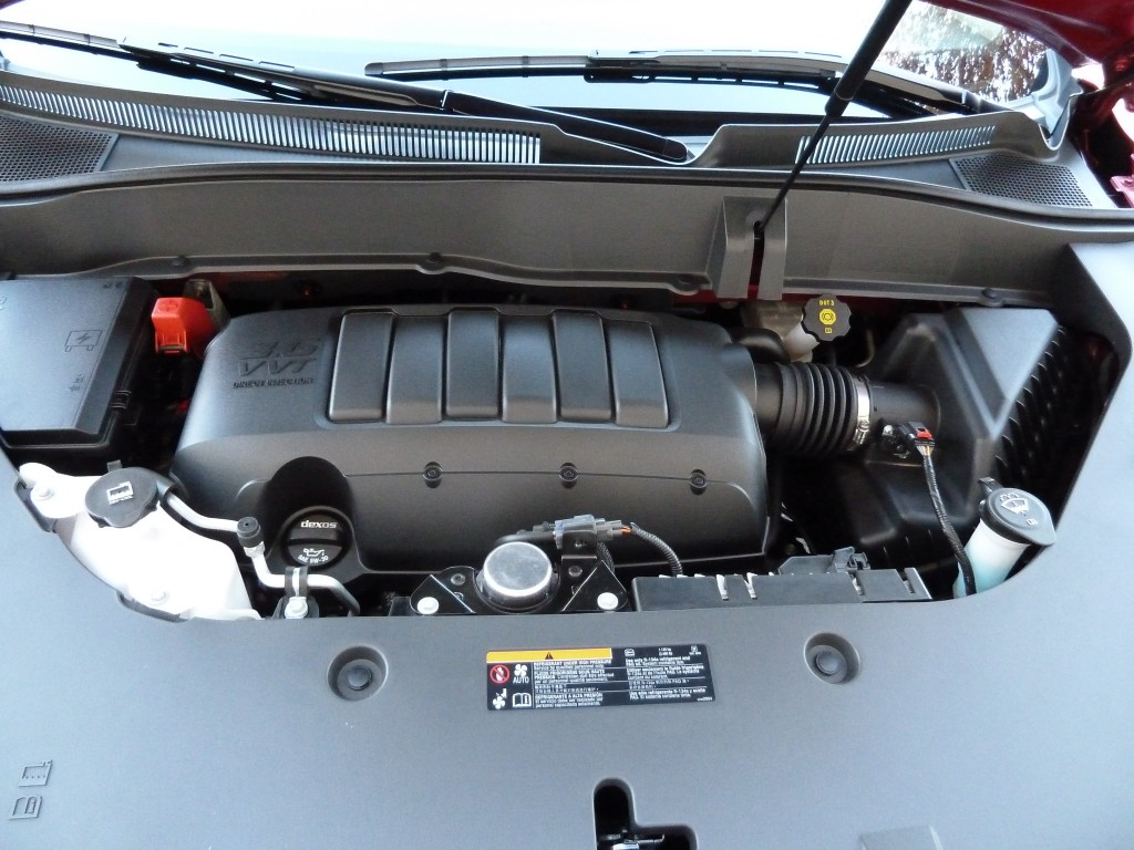 Believe it or not, the GMC really has an engine, and a fine one, underneath all that plastic shrouding