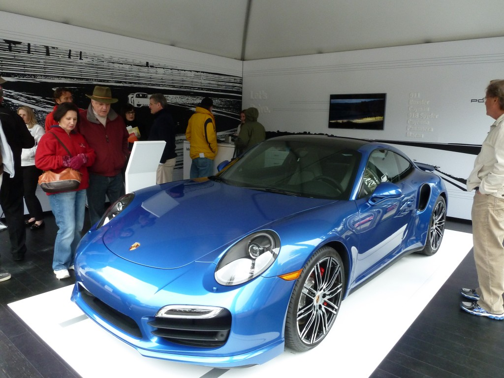 """Porsche's """"tent"""" is really a mini showroom, with free magazines and brochures for all"""