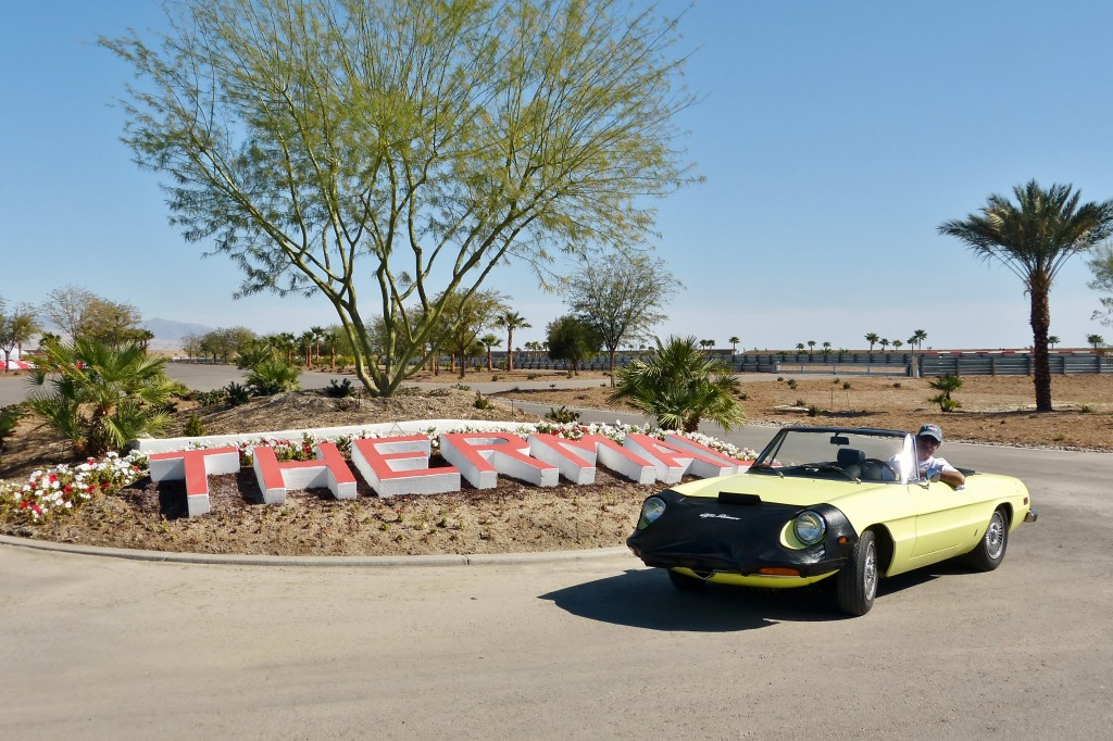 My buddy Jeff and his fabulous Alfa Spyder at the entrance to The Thermal motorsports countryclub restort fantasyland