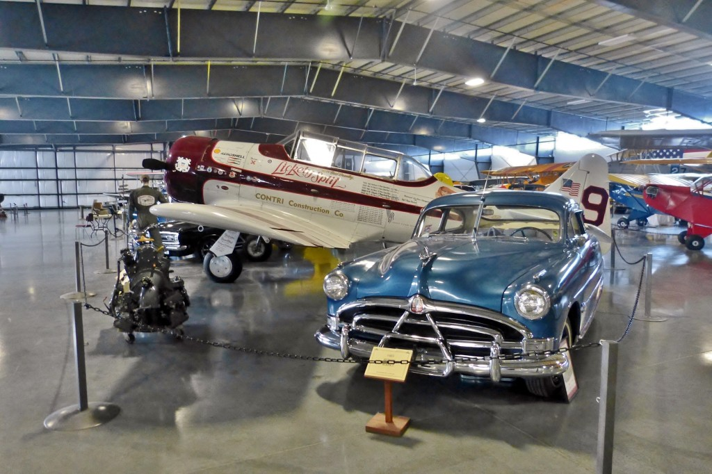 The curators display many of the cars/bikes/planes with cars/bikes/planes of the same era