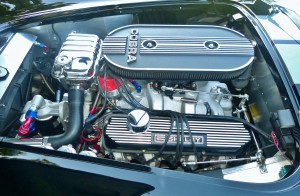Got to give this builder credit for equipping his big-block Cobra bodied replica with an actual big-block Ford FE V-8 engine, very much resembling that of an actual Cobra 428. Its not authentic in every detail but correct in many, and certainly right for the spirit of the car -- and it must go like hell.