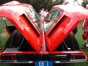 Who doesn't love gullwinged cars, but in this case the winged doors allow access to the engine not the passenger compartment.  It is of course a Giugiaro designed, Ghia-bodied deTomaso Mangusta from the late 1960s.  One of the great exotic car designs ever.  Period ever.