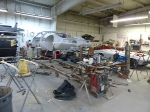 Restoration ground zero, on the right a mid-year Corvette roadster getting the full treatment, and at left is a DeTomaso Mangusta that's been taken down about as far as you can.  It will be perfect when done, I'm sure.
