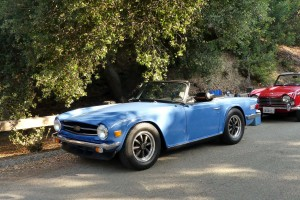 I love Triumph TR6s and 4s; here's a fine example of each, and will own one someday.