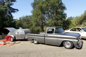 You couldn't ask for a more charming presentation than this immaculate early 60s Chevy pickup and its neatly polished, semi-teardrop travel sleeper.