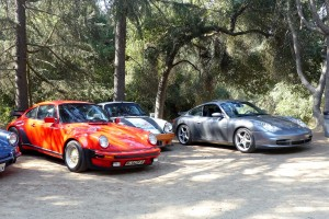 That's shooter Kirk's handsome gray 996 coupe on the right in the Porsche paddock.