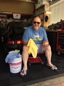 yup that's me. Tired, hot, smelly and sore. With my tin of just used Mothers Synthetic Paste wax. The black Porsche and garage are also mine.