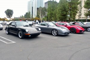 My '89 Carrera 3.2 at left, Kirk's gray 996 in the middle, and Jeff's tastilicious red Cayman GTS on the right.
