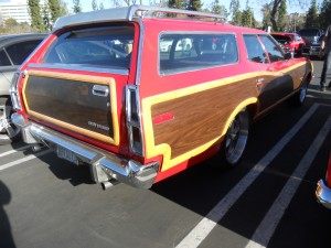 Long live the 70s, baby. Check out this faux wood clad '73 Gran Torino Squire, disco boy.