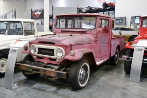"Many of the vehicles on display are virtually new with no miles on them, some more ""experienced"" like this wonderfully patinated FJ45 pickup."