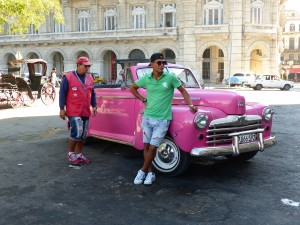 Two young tour taxi dudes troll for fares in their brightly colored clothing and '46 Ford convertible.