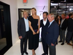 Derek Bell, Patrick Dempsey, and Hurley Haywood are the short guys -- you can likely tell which one is Maria Sharapova.