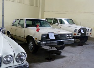Early 80s Malibu flanked by really rusty Daimler Sovereign and big Jag.