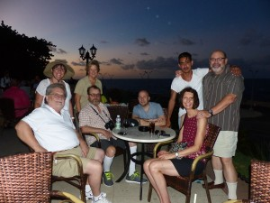 My Team Cuba 2016, from left, Dave, behind him, lovely woman smiling with hat, Brenda Priddy, seated next to Dave Michael, behind him sig other Ilene, then shaved head tour director Matt Smith, Linda seated, behind her our local Cuban Guide Alejandro, and fat American boy me. Drinks at sunset along the water at the famous Hotel Nacional.
