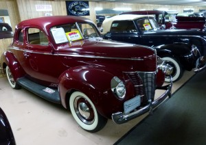 Love this OUTSTANDING '40, and nothing wrong with the Ford ragtop next to it either.